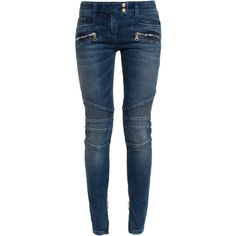 Balmain's classic biker jeans are a chic fashion-house favourite.  This blue denim variation boasts the label's signature gold-tone hardware, logo-embossed but…