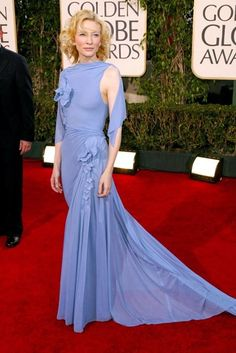 65 Best Golden Globe dresses of all time - CATE BLANCHETT - Every now and then, you see a dress on the red carpet that makes such an impression that it cements itself in your memory forever. This was one of those moments. Cate Blanchett made waves when she stepped out in this heavenly periwinkle Jean Paul Gaultier creation, which included romantic draping and floral accents.(2005)