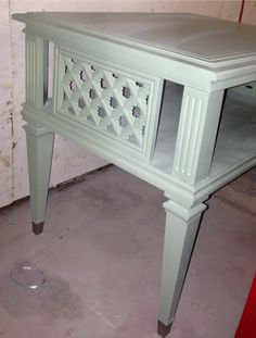 Reprinted side table in almost a soft mint color. Metal footings received metallic paint accent too.