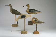 """FOUR CARVED AND PAINTED SHOREBIRD DECOYS INCLUDING ONE SIGNED """"H.V. SHOURDS"""" AND TWO STAMPED """"STEVENS."""""""