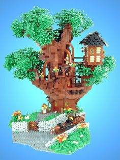 Lego tree house. Next time the boy tells me he's bored we're pullin the Lego bucket out! See how creative we can get.