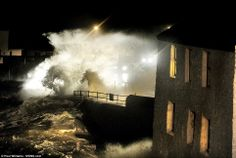 Danger: The small coastal village of Port Melon near Mevagissey in Cornwall has been battered by storm force winds and mountainous seas in the early hours yesterday