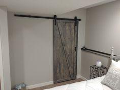 Rustic stained grey sliding barn door.