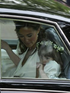 Kate's sister, Pippa, rides with a young bridesmaid, Eliza Lopes, the 3-year-old granddaughter of Camilla, Duchess of Cornwall on the way to Westminster Abbey.