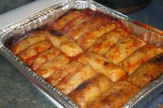 Easy Ukrainian Cabbage Rolls! Bacon, onion, rice and tomato soup! This is pretty much how we make ours except we poke the ends in!