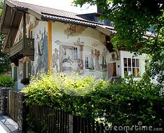 Photo made in Oberammergau in Bavaria (Germany). The picture shows a house with frescoes depicting the tale of Red Riding Hood. The country is known for its houses painted with subjects of famous fairy tales.