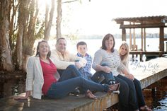 Family photo session at the lake, pics on a boat and on the dock! Great ideas! Gorgeous lighting!