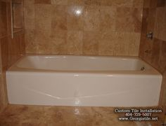Google Image Result for http://www.georgiatile.net/images/tub_shower_travertine_tile_ideas/l/travertine_tub_shower_ideas_images_pictures_09.jpg