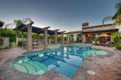 Outside features a beautiful center courtyard with fully tiled pool, spa, intimate smaller patios, a fireplace, kitchen and BBQ, fountains, and soaring desert and mountain views. All of this for a price of $3.750,000