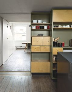 This sliding storage wall can be tucked aside to allow a seamless connection to the living and dining area.