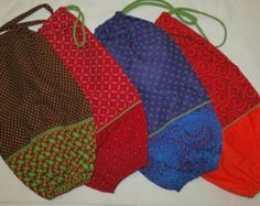 Handmade plastic bag holders made from Shweshwe pure cotton fabric.