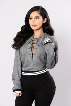 - Available in Heather Grey - Lace Up Hoodie - Athletic Band - Loose Fit - Long Sleeve - Made in USA - 16% Cotton 84% Polyester