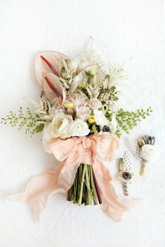 Such gorgeous flowers in this bouquets - anthurium, astilbe, ranunculus, anemone, roses, berries...So feminine.
