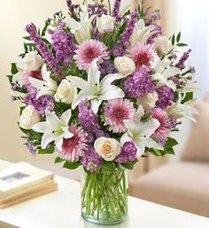 Sincerest Wishes Lavender and White Arrangement Offer your heartfelt wishes by sending this lovely lavender and white arrangement of roses, lilies, liatris, cremones and stock to show you care. •This