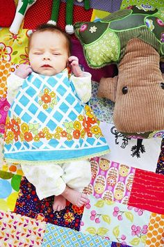 tiny baby in a patchwork forest.