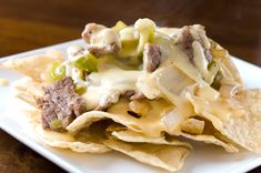 Philly Cheesesteak Nachos YUM! For a quick and easy steak replacement use deli roast beef (thinly sliced). Do no use prepackaged deli meat. Just chop and saute in a lightly greased pan. Once meat is heated through...add about a tablespoon of water to make sure meat doesn't dry out and cover while you prepare the rest of the ingredients. Enjoy : )