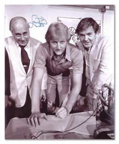 Larry Bird signing his rookie contract Red Auerbach and Bill Fitch