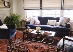 Living Room Navy Sofa And Chairs Red Pattern Rug
