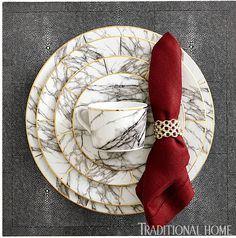 """Get this marbled look: """"Keon"""" napkin ring in tarnished silver. """"Elini"""" marble-inspired porcelain dinnerware with gold edge. """"Henry"""" faux shagreen square placemat in cool gray. All from Blue Pheasant.  - Photo: Marty Baldwin"""