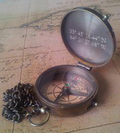 "Manly replica compass in a wooden case, box. Great for engraving a quote, gps coordinates, wish.  Great for a son leaving for boot camp or for a daughter going over seas.  To your friend who is moving away, or a child leaving home.  To your new husband as a wedding gift. ""Let our adventures begin now"" great idea for a desk top weight as well."