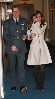 Kate with Prince William after his graduation, now a Royal Air Force pilot, wearing a pretty peacoat.                                     via @AOL_Lifestyle Read more: http://www.aol.com/article/2015/03/06/kate-middletons-style-transformation-all-of-her-best-royal-loo/20642964/?a_dgi=aolshare_pinterest#slide=12059|fullscreen