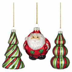 "3 Santa Claus-themed blown glass ornaments.  Product: 3 OrnamentsConstruction Material: GlassColor: MultiDimensions: 3.5"" H (trees)"
