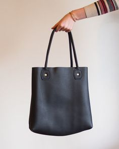 6a7e279cb3c3 This modern black leather tote slouches perfectly and is very sturdy. Black  Leather Tote