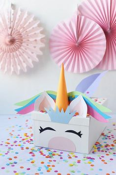 Turn a simple white card box into something magical with our tutorial for a DIY Unicorn Valentine's Card Box! Your kids will love it.