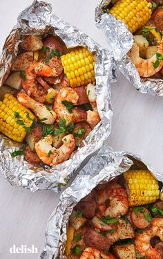 Shrimp Foil Packets Are The No-Mess Grilled Dinner Of Your Dreams Shrimp Foil Packets Are The No-Mess Grilled Dinner Of Your Dreams,Schnelle Rezepte Shrimp recipes recipes meals ideas recipes Shrimp In Foil Packets, Shrimp Boil Foil, Foil Packet Meals, Shrimp Boil Party, Grilled Foil Packets, Shrimp Bake, Cajun Seafood Boil, Tin Foil Dinners, Hobo Dinners