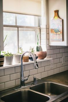 Making It Work In A Bare-Bones Texas Home | A collection of succulents sits on the kitchen windowsill. (6 of 15)