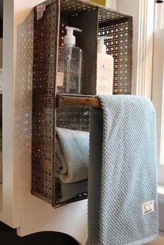 Turn basket on it's side for shelf and towel holder.