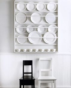 Currently searching for the simplest wall plate rack to use as children books display. // Photo via Architectural Digest Magazine. #BonnieTsangEdit