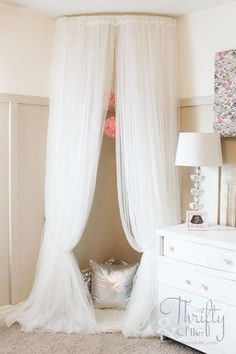 22 Chic Feminine Ispired Interiors Messagenote.com Whimsical Canopy Tent or Reading Nook made from curved curtain rod and $4 ikea curtains