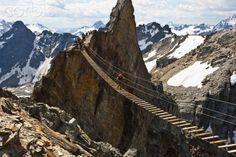 Climbing the Via Ferrata on Nimbus Tower in the Columbia Mountains. Bugaboo provincial park.