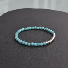 NEW Sterling Silver and Turquoise Howlite beaded stretch bracelet