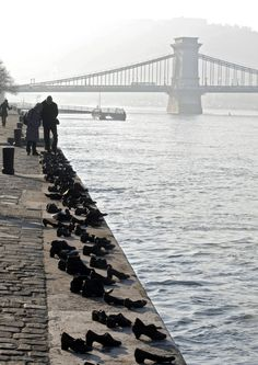 Created by Can Togayand Gyula Pauer,The Shoes On The Danube Bank were designed as a remembrance for the hundreds of Hungarian Jews who had to leave their shoes on the bank of the river before they were shot during the Holocaust in Hungary. in Most Fascinating Public Sculptures Photos | Architectural Digest