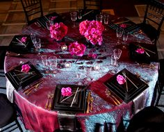 Pink iridescent crush table cloth paired with stark black square plates and gorgeous pink orchids