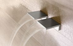 Sbalzo, stainless steel wall mounted waterfall taps by Antonio Lupi #architecture #interiors #design #bathroom #taps