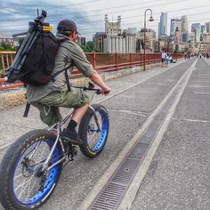 Kicked off Memorial Day weekend in #minneapolis following my cousin on #bike (with #camera gear in tow)! Check out his #photography at http://ift.tt/1O05ozE. #onlyinmn #holiday #weekend #travel #skyline #stonearchbridge @chris_broste_photo by travelingjules