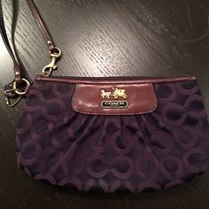 Used purple Coach wristlet. Used wristlet, but fabulous size (fits a cellphone, some cards, your keys and lip gloss), and a great color. Coach Bags Clutches & Wristlets