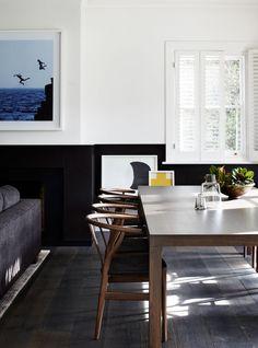 Black wainscoting in a modern living room/dining room--image via Geraldine Tan