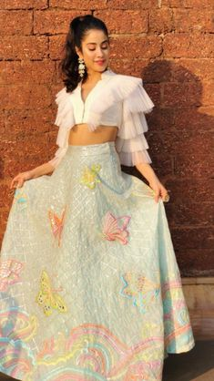 Janhvi Kapoor turning heads in Manish Malhotra's mirror reflective trail gown. She's looking glamorous in this gown in Italy. Party Wear Indian Dresses, Designer Party Wear Dresses, Indian Gowns Dresses, Dress Indian Style, Indian Fashion Dresses, Indian Wedding Outfits, Indian Designer Outfits, Bridal Outfits, Indian Outfits