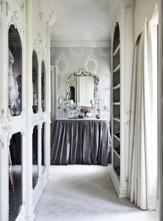 Sophisticated dressing table the skirt hides extra storage space beneath.  Like the use of the narrow closet space with mirrored doors and drape to hide treasures.