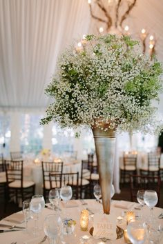 Wedding at The Pavillion of the Galleria Marchetti in Chicago, Illinois.  Tall Baby's Breath Centerpiece | photography by http://www.justinebursoni.com/