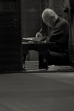 The head priest of Kegonji Temple signing the shuincho (a pilgrimage), Gifu, Japan