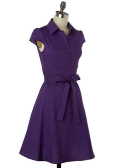 This 1950s-inspired dress is perfect for an after-school date at the ice cream parlor! Wearing this deep purple, your beau will spot you right away. And, as you share an ice cream float, he'll admire the fabric-covered buttons and the dainty cap sleeves. The fitted bodice is the perfect accompaniment to the slightly flared skirt and cinched waist with a matching sash. As you lean in for a sip, the subtle stretch of this cotton-blend dress will keep you comfortable.   (Love the description)