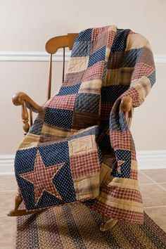 Patriotic Patch Throw- The hand-quilted Patriotic Patch Throw features assorted patchwork blocks in traditional Americana colors of red, navy blue and tan.Stitch in the ditch and echo hand-quiltingFeaturing assorted patchwork blocks in traditional Am Primitive Quilts, Country Primitive, Rustic Americana Decor, Primitive Curtains, Americana Crafts, Patriotic Crafts, Colchas Quilt, Patch Quilt, Blue Quilts