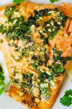 """CILANTRO LIME HONEY GARLIC SALMON ~~~ know that this is not an """"en papillote"""" application. the foil julia uses in this recipe serves as a vessel vs that of a baking enclosure. [juliasalbum]"""