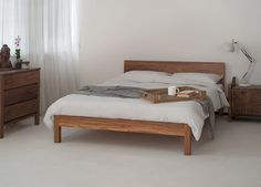 Simple washed linen bedding with a solid walnut Sahara bed - the neutral colour scheme is so relaxing and stylish!