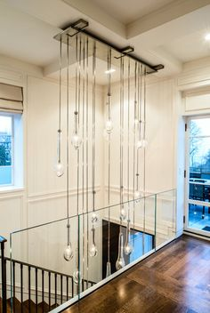 Decorating: Foyer Lighting With Unique Chandeliers And Coffered Ceiling Also Wall Paneling And Window Treatments Plus Glass Railings And Hardwood Flooring , staircase design, lighting fixtures ~ parsegallery Stairway Lighting, Foyer Lighting, Lighting Design, Lighting Ideas, Entry Chandelier, Edison Light Chandelier, Pendant Lighting, Chandelier Ideas, Pendant Chandelier